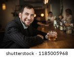 elegant man in expensive suit... | Shutterstock . vector #1185005968