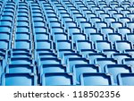 Folded blue plastic chairs on a temporary  tribune - stock photo