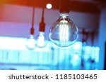 hanging retro style light bulbs ... | Shutterstock . vector #1185103465