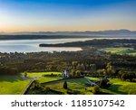 lake starnberg in front of alps ... | Shutterstock . vector #1185107542