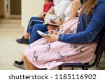 a pregnant woman in courses for ... | Shutterstock . vector #1185116902