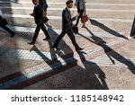 business people commuting to... | Shutterstock . vector #1185148942