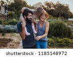 beard man carrying little girl... | Shutterstock . vector #1185148972