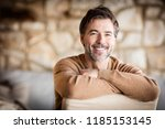 portrait of a handsome mature... | Shutterstock . vector #1185153145