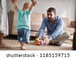 happy parents playing with... | Shutterstock . vector #1185159715