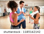 group of exercisers with towels ... | Shutterstock . vector #1185162142