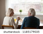 rear view at happy senior old... | Shutterstock . vector #1185179035