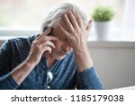 frustrated older mature retired ... | Shutterstock . vector #1185179038