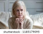 thoughtful upset mature old... | Shutterstock . vector #1185179095
