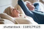 senior aged couple relaxing on... | Shutterstock . vector #1185179125