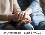 Small photo of Close up view of mature couple holding hands, loving caring elderly man supporting senior middle aged woman giving psychological empathy and understanding in marriage, getting older together concept