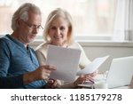 happy old middle aged couple... | Shutterstock . vector #1185179278