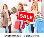 Shopping women at Christmas sales holding gift box. - stock photo