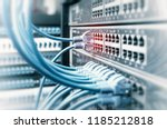 Stock photo network cables in switch and firewall in cloud computing data center server rack 1185212818