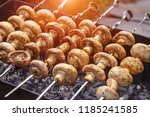 barbecue skewers with delicious ... | Shutterstock . vector #1185241585