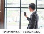 businessman holding a photo... | Shutterstock . vector #1185242302