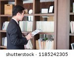 businessmen hold a check on the ... | Shutterstock . vector #1185242305
