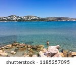 man swimming in aegean sea by... | Shutterstock . vector #1185257095