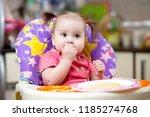 baby eats pasta sitting in... | Shutterstock . vector #1185274768