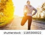 fitness woman runner stretching ... | Shutterstock . vector #1185300022
