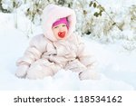 Baby Girl Sitting In Snowdrift