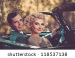 Retro couple in convertible - stock photo