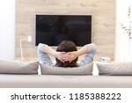 young woman watching tv in the... | Shutterstock . vector #1185388222
