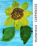 Flower Of A Sunflower On A Blu...