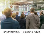 business people watching a tour ... | Shutterstock . vector #1185417325
