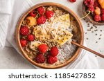 oatmeal porridge with chia... | Shutterstock . vector #1185427852