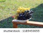 delicious ripe grapes in plate. ... | Shutterstock . vector #1185453055