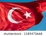 turkish flag waving in blue sky.... | Shutterstock . vector #1185473668