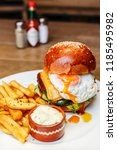 freshly cooked burger with... | Shutterstock . vector #1185495982