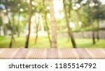 wooden table top on green... | Shutterstock . vector #1185514792