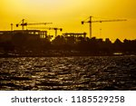 sunset is painting the sky with ... | Shutterstock . vector #1185529258
