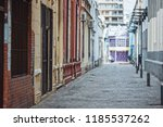 deserted dark alley | Shutterstock . vector #1185537262