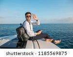 positive caucasian freelancer... | Shutterstock . vector #1185569875