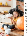 cute little girl in witch...   Shutterstock . vector #1185571618