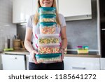 Woman Holding Containers With...