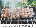 preparing shashlik on mangal....   Shutterstock . vector #1185693412
