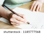 writing letter to a friend.... | Shutterstock . vector #1185777568