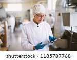 young focused female worker in... | Shutterstock . vector #1185787768
