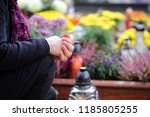 women at the cemetery is... | Shutterstock . vector #1185805255