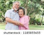 happy elderly couple with...   Shutterstock . vector #1185855655