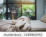 brown themed bed sheets and... | Shutterstock . vector #1185863452