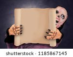 ghost holding paper poster in... | Shutterstock . vector #1185867145
