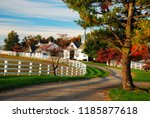 Small photo of Lexington, KY, USA October 20, A meandering country road traverses a fall landscape in Kentucky's Blue Grass region near Lexington
