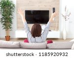 young happy woman watching...   Shutterstock . vector #1185920932