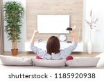 young happy woman watching...   Shutterstock . vector #1185920938