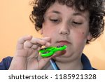 boy playing with fidget spinner ... | Shutterstock . vector #1185921328